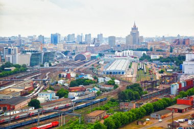 MOSCOW, RUSSIA - JUNE 9, 2014: View of Moscow - railway, railway station, railroad Depot, high-rise residential buildings