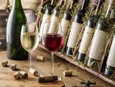 Photo Wine bottles on the wooden shelf.
