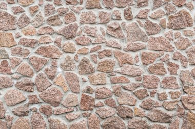 Stone wall (fense). Close-up picture of bricks.