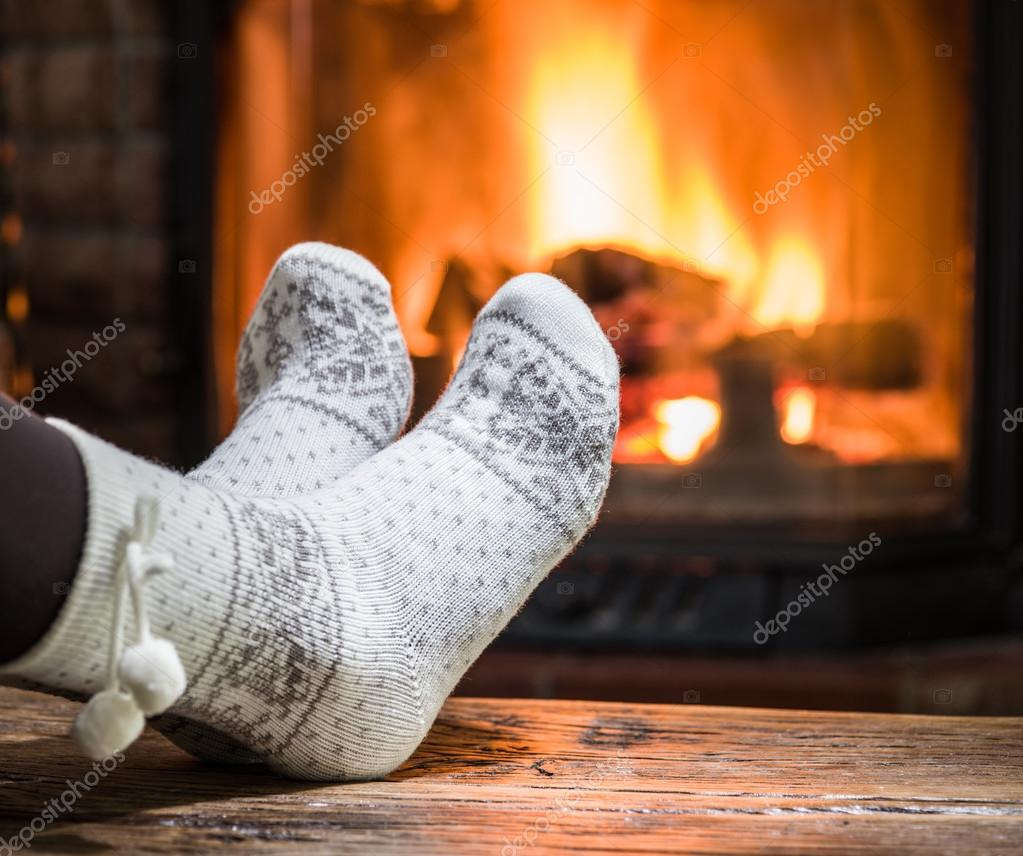 Warming and relaxing near fireplace  — Stock Photo