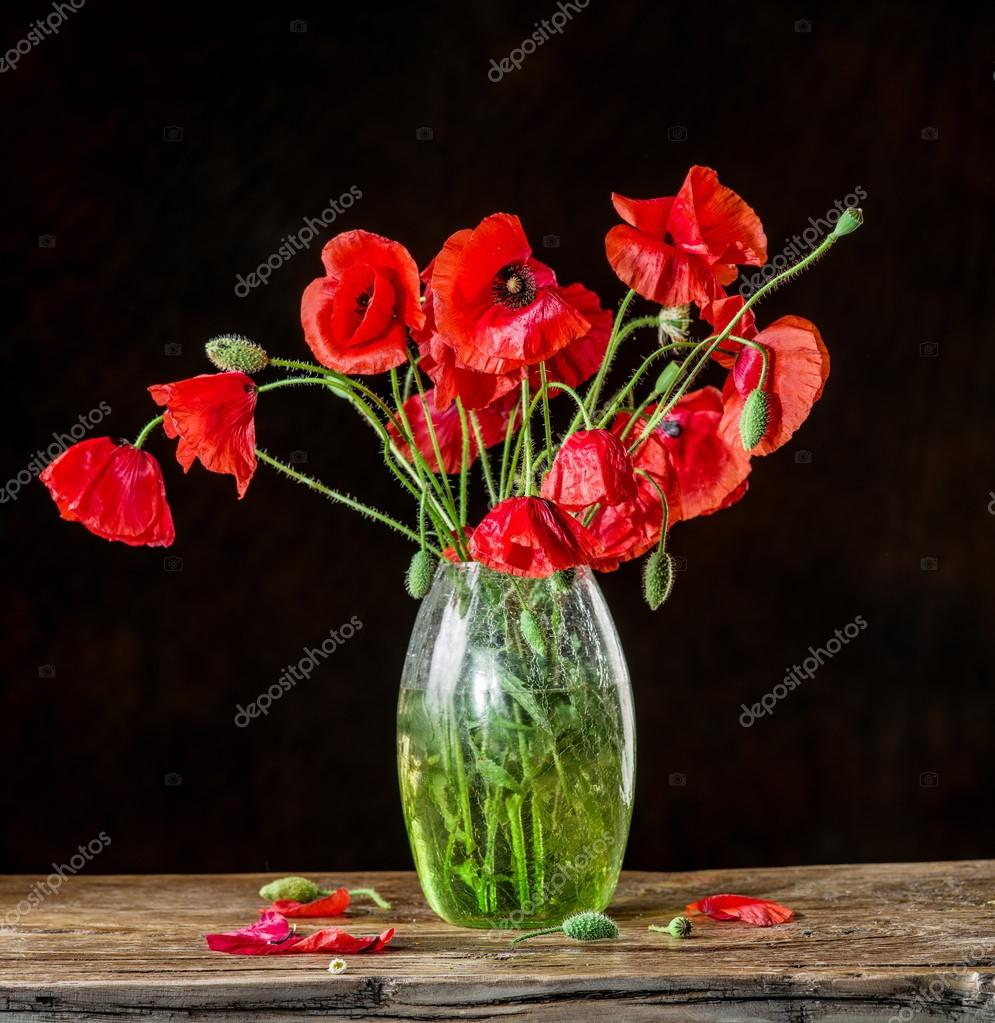 Bouquet of poppy flowers in the vase on the wooden table stock bouquet of poppy flowers in the vase on the wooden table photo by valentynvolkov reviewsmspy