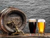 Fotografie Glasses of  beer and ale barrel on the wooden table. Craft brewe
