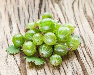 Gooseberries on the wooden table.