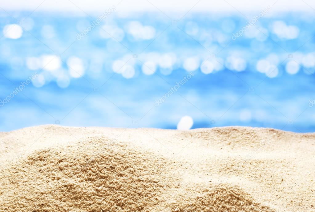Sand with blurred sea background.