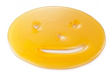 Honey droplet in the form of smiley.