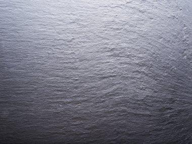 Rough graphite background. Closeup shot.