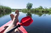 Fotografie Mans legs over canoe. Resting time.