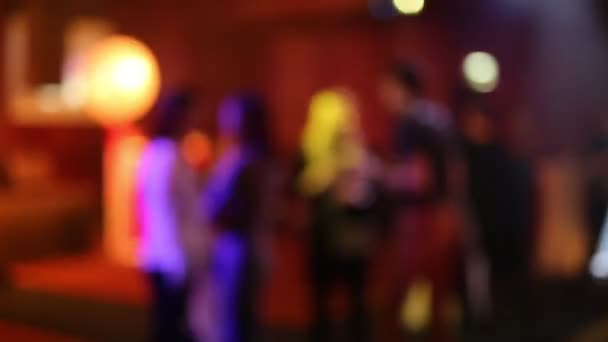 Blurred dancing stage at night club.