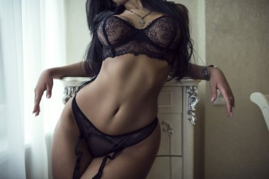 Model in black lingerie posing