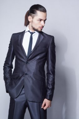 Stylish man with long hair in elegant blue suit