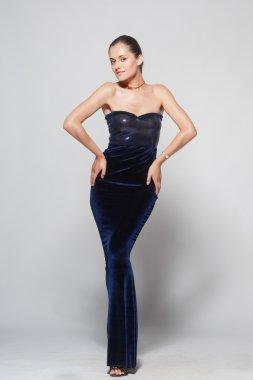 Sexy woman in long blue dress, Studio shoot