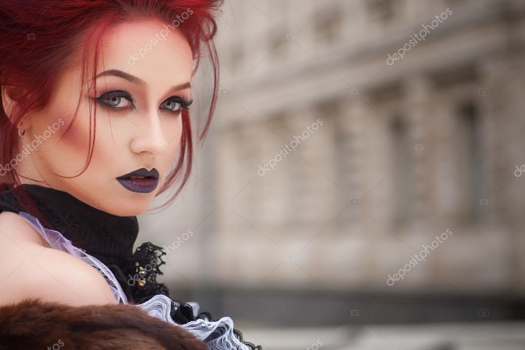 Sexy Woman With Gothic Makeup And Red Hair Castle Stock Photo
