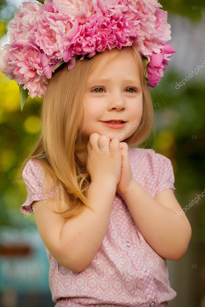 377444739e30 Beautiful baby girl with blonde hair outdoors. Little girl 2-3 year old–  stock image