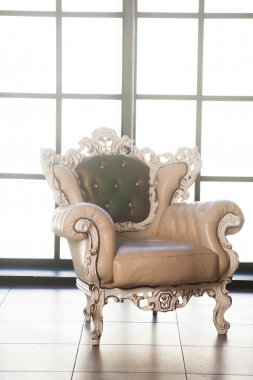 beautiful Baroque armchair near a big window