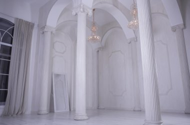 Beautiful white hall baroque with columns and with high ceilings