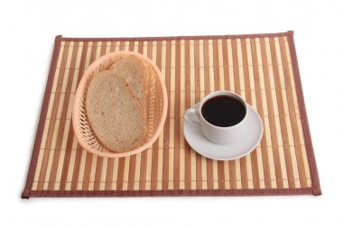Cup and bread on wood table
