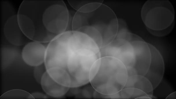 Abstraktní kruhové bokeh černé a bílé pozadí
