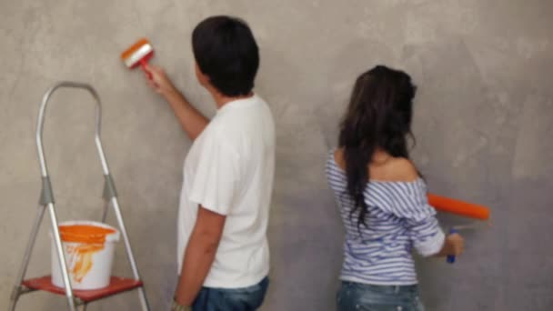 Couple painting wall