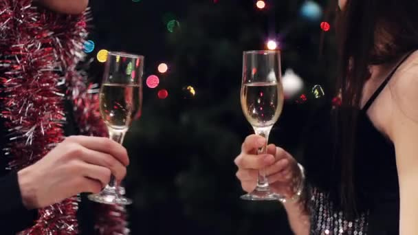 Couple toast at christmas party