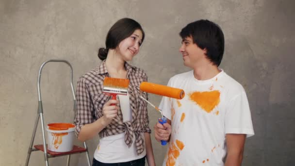 Couple with holding brushes