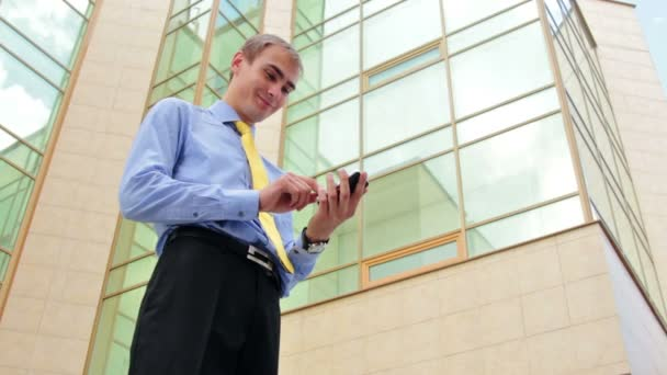 Businessman texting on cellphone