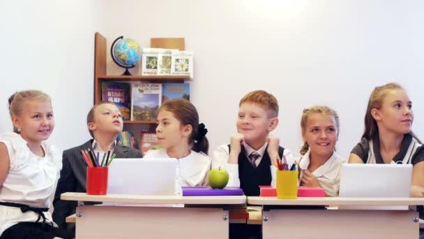 Schoolchildren showing success together
