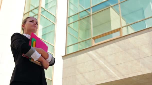 Student holding her copybooks