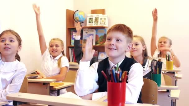 Children raising hands during the lesson