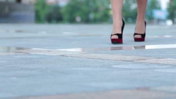 Walking woman in modern shoes
