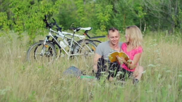 Couple holding books