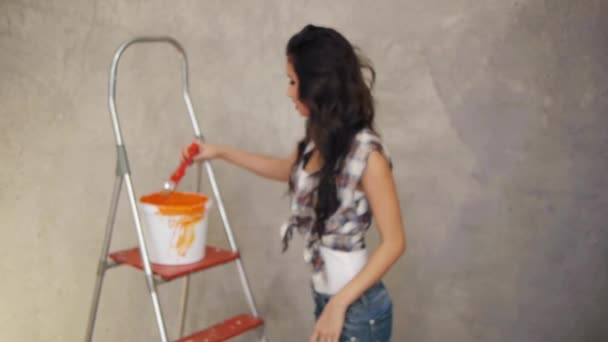 Woman painting screen