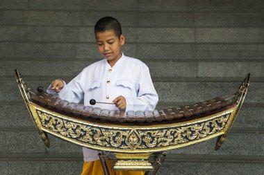 Boy playing xylophone in Bangkok