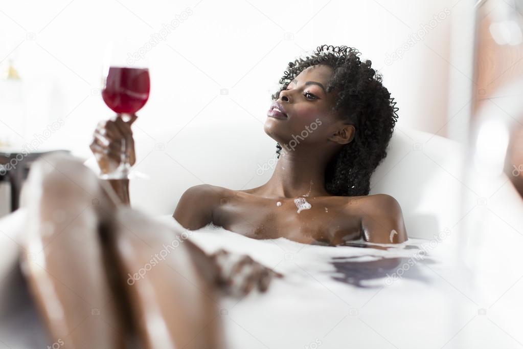 Pretty black woman having a bath