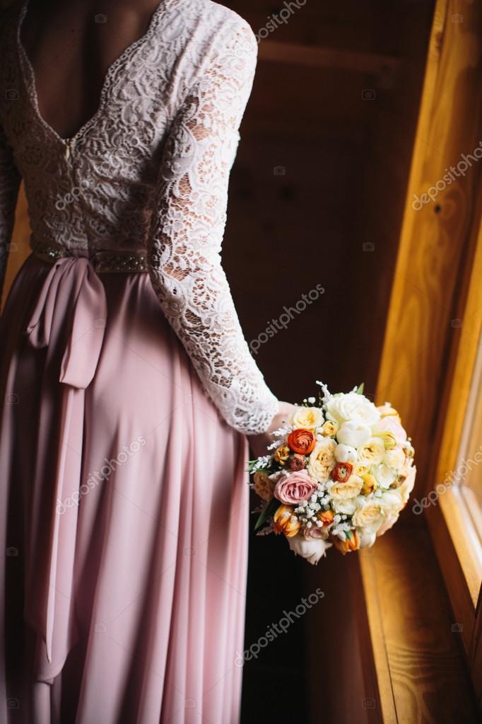 Bride holding her flower bouquet