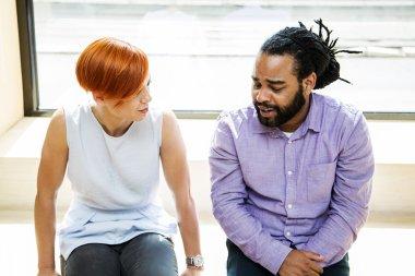 Multiracial friends talking