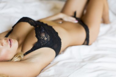 Blond woman on the bed