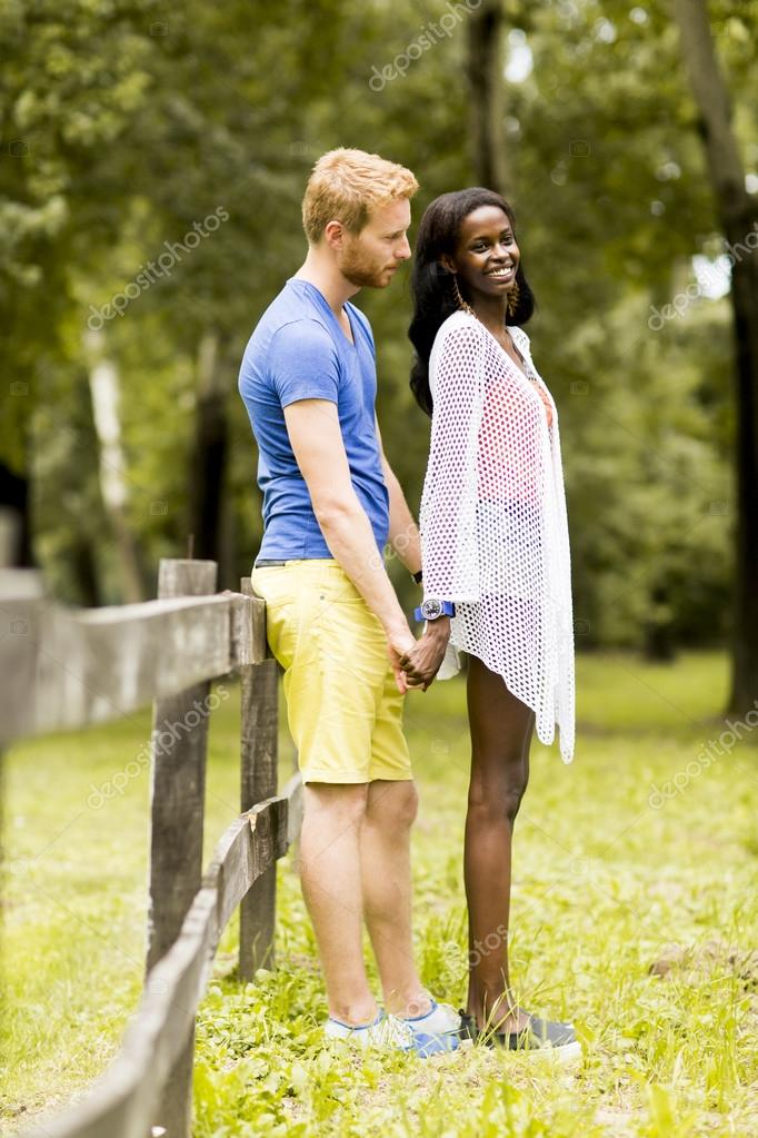 Loving couple by the fence