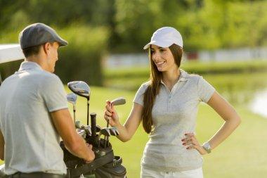 Couple at golf cart