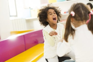 Liitle girls at playroom