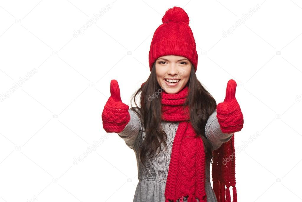 Winter woman thumb up
