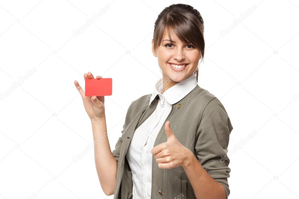 smiling business woman holding credit card and showing tumb up