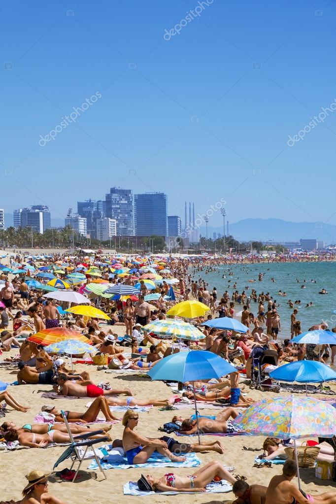 People At Platja Del Bogatell Beach In Barcelona Spain Stock