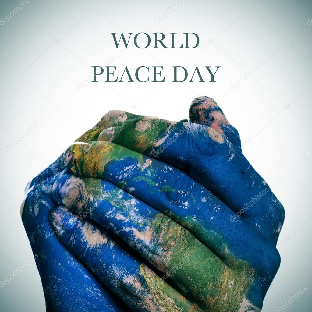 World peace day earth map furnished by nasa foto de stock the sentence world peace day and a world map in man hands forming a globe earth map furnished by nasa foto de nito103 gumiabroncs Gallery