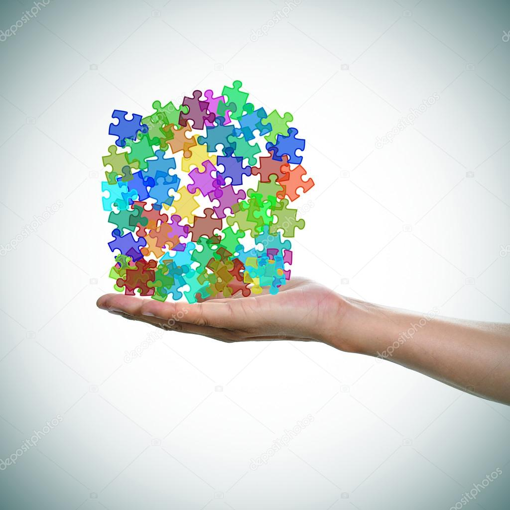 Puzzle pieces of different colors as the symbol for the autism a a man hand with a pile of puzzle pieces of different colors as the symbol for the autism awareness photo by nito103 biocorpaavc