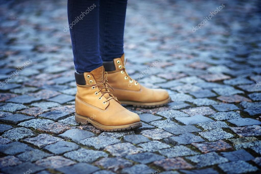 Womens feet in yellow boots