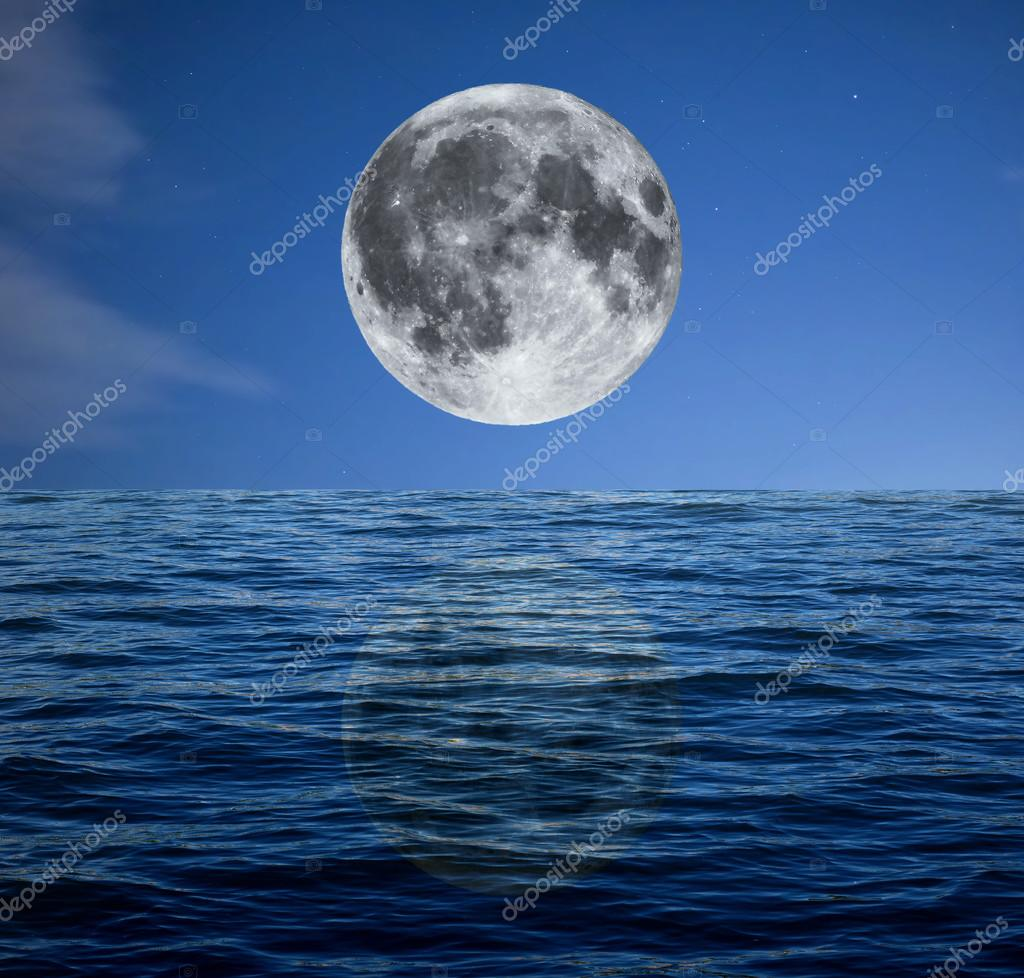 Full moon at night over the sea