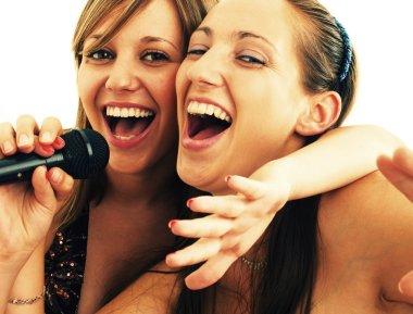 Girls singing karaoke