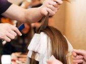 Woman having  hair colored