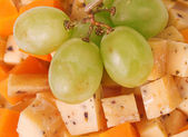 Fotografie Cheese cubes with grapes