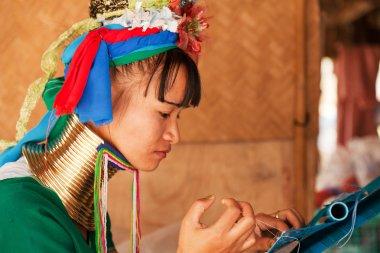 Long neck woman weaving